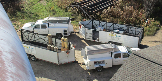 SolarBee GridBee service vehicles on a tank location