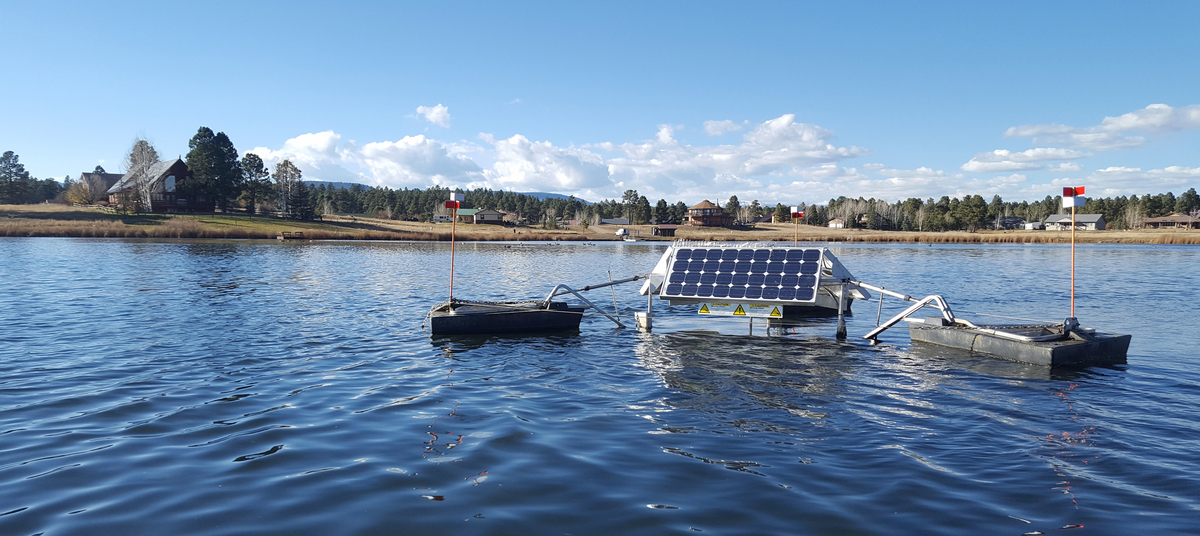 A SolarBee Circulator in the middle of a home owners lake