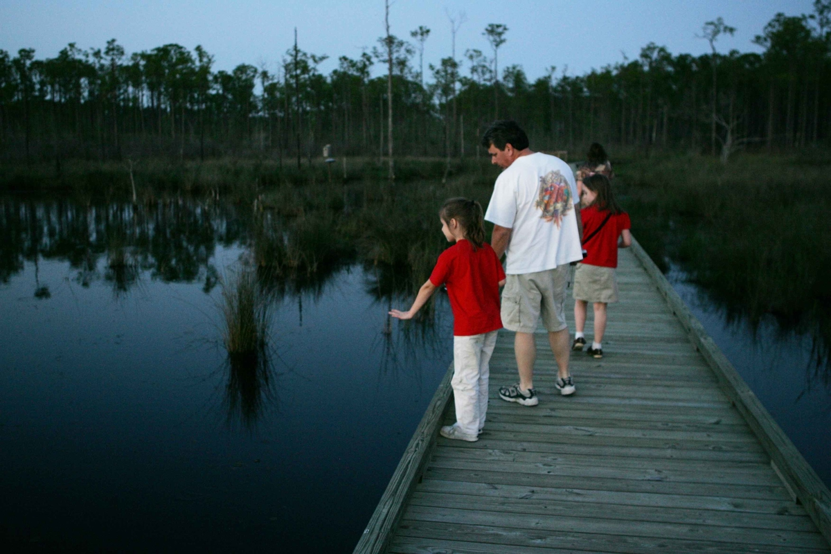 Family walking on dock.