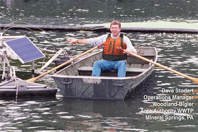 happy customer in boat on wastewater pond near SolarBee mixer