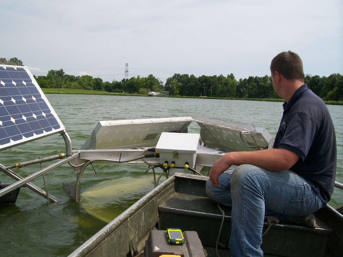 Medora Corporation Crew testing water next to a SolarBee®